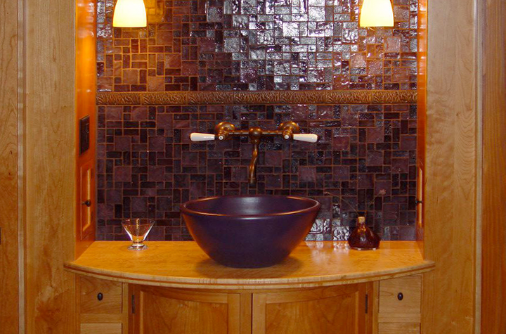 basin-with-curved-cabinetry-and-tile-backsplash