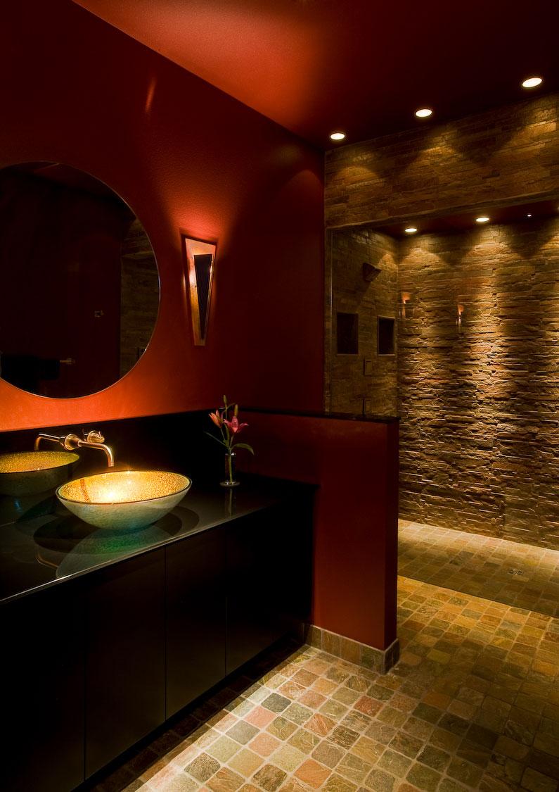 stone-tile-walls-glass-shower-wall-granite-countertop-arty-basin-serene-lighting