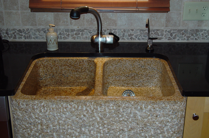 detail-speckled-granite-farmhouse-style-sink-textured-tile-backsplash-classic-fixtures