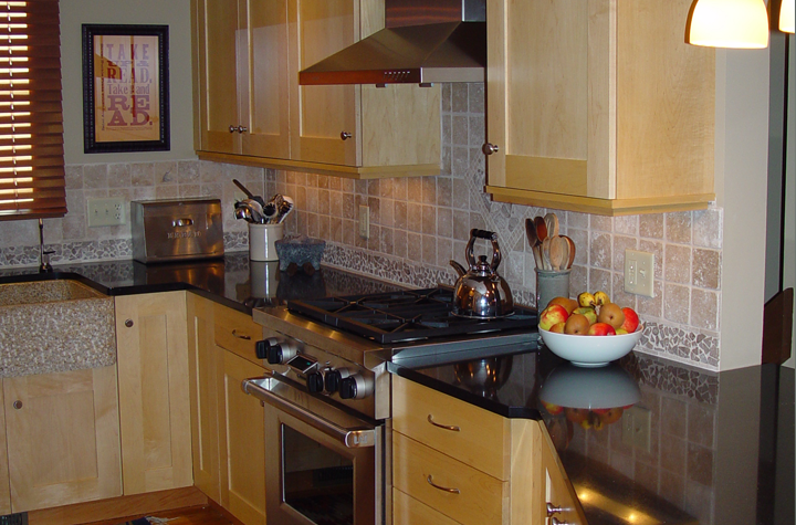 gas-range-marble-counter-tile-backsplash-maple-cabinetry