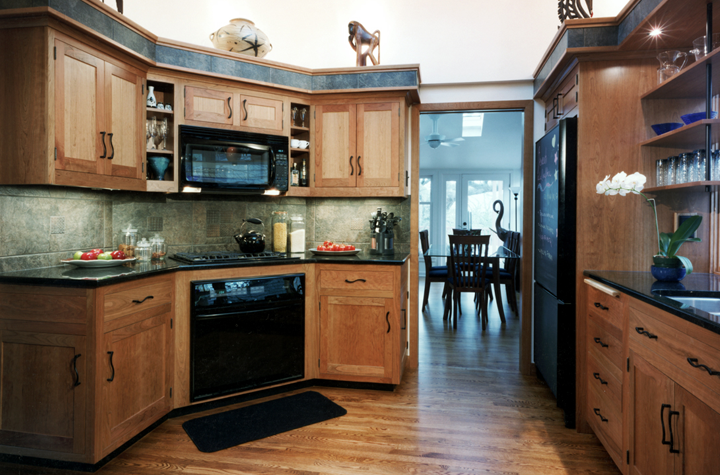 corner-appliances-wiht-granite-counters-and-tile-backsplash-custom-woodwork-shelving-above